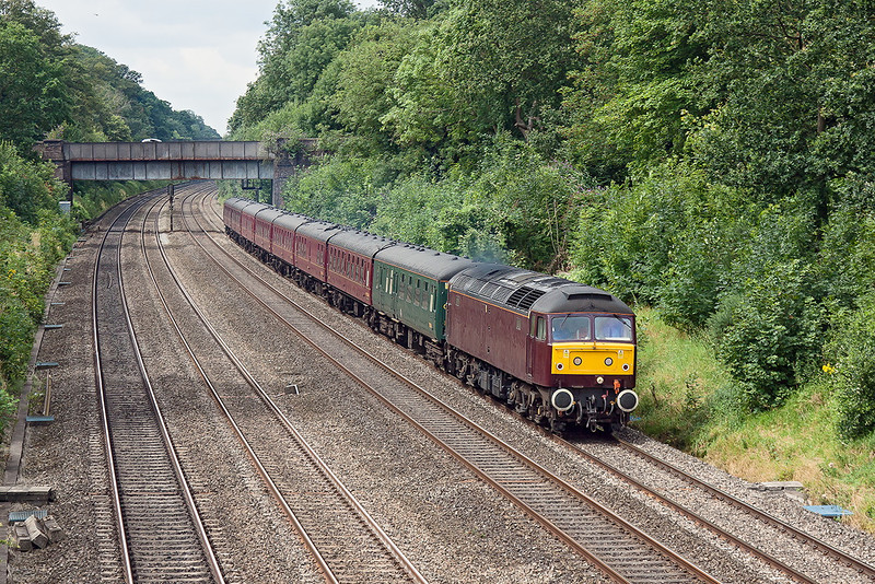 6th Aug 12:  In a little hazy sun West Coast Railways' 47500 trots thrugh the Sonning Cutting with Rail Tour ECS from Bristol. Captured at Duffield Road in Sonning