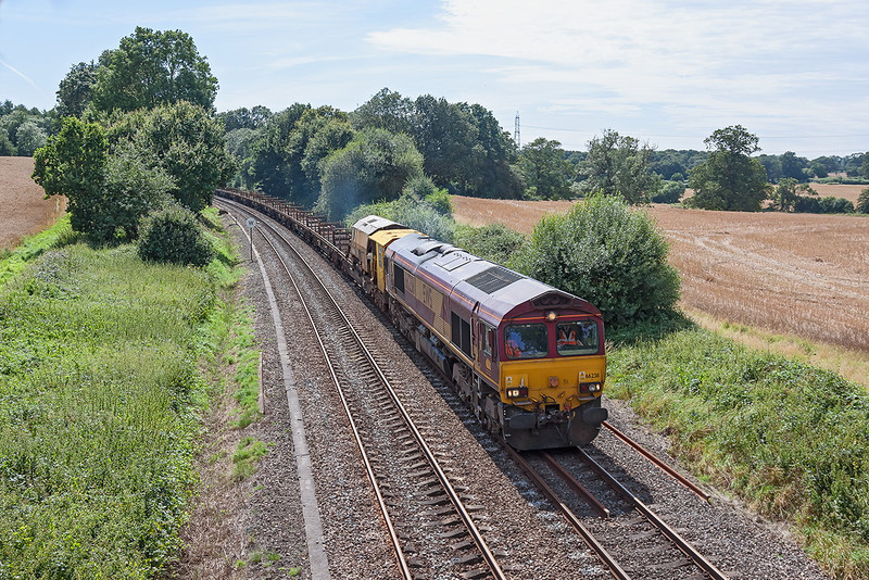 17th Aug 12:  The Afternoon Departmental from Eastleigh to Hinksey wirh 66238 on the point hurries through Silchester