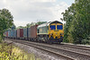 28th Aug 12:   4M61 to Trafford Park from Southampton with 66536 at the helm charges up the hill and away from Mortimer