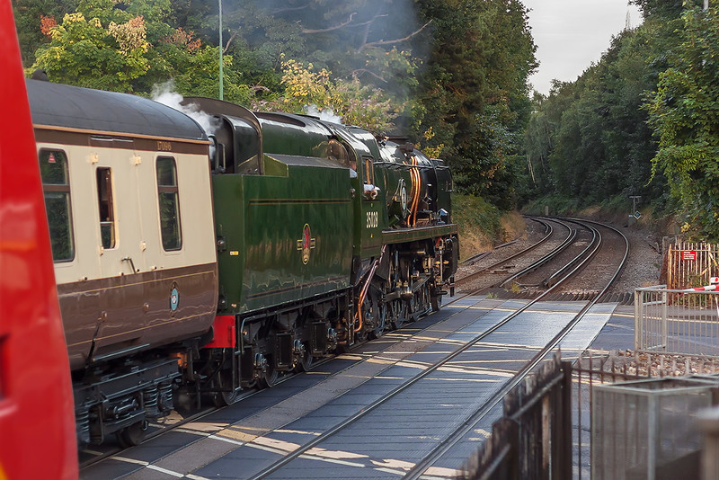 17th Aug 12:  Racing across the A30 at Sunningdale is 35028 'Clan Line' returning the VSOE to Victoria from Oxford. The The Waterloo to Reading Juniper was in-opportune to say the least !