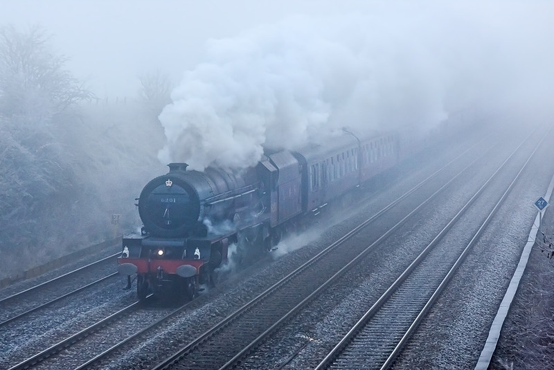 1st Dec 12:  Looming out of the mist at Shottesbrooke Farm is LMS 4-6-2 6201 Princess Elizabeth heading to Worcester from Paddington.  It was bright sunshine in Bracknell when I left home, Some you win and some....!