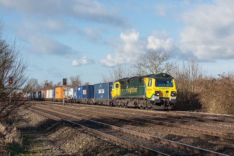 4th Dec 12:  4O49 the 09.23 drom Basford Hall (Crewe) with 70020 at the helm hurries through Lower Basildon