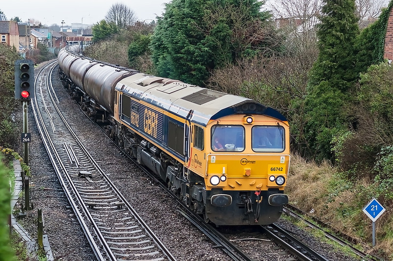 24th Dec 12:  My Christmas Eve bonus was to get my first picture of 66742 as it ran through Egham with empty oil tanks from Harwich  Parkstone Quay to Holybourne,  Shot settings were  TV 1/500 @ f2.2 -2/3 stop.  Canon 50mm f1.4 prime. 800 iso