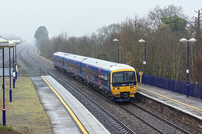 22nd Dec 12:  165102 forms the 11.18 from Reading to Paddington.  2P43 is captured as it arrives at Taplow