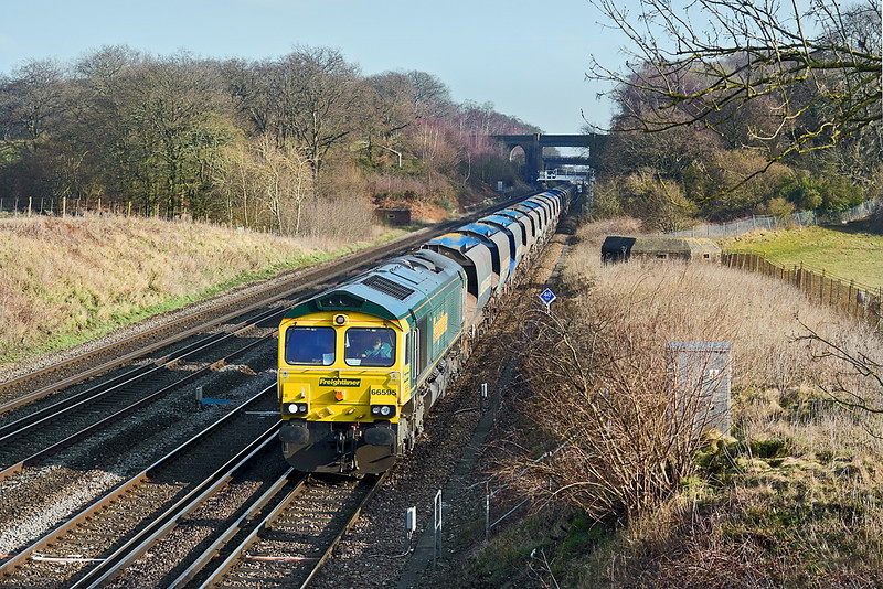 1st Feb 12:  66595 trots past Totters Lane working 6O49 the sand empties from Neasden to Wool.