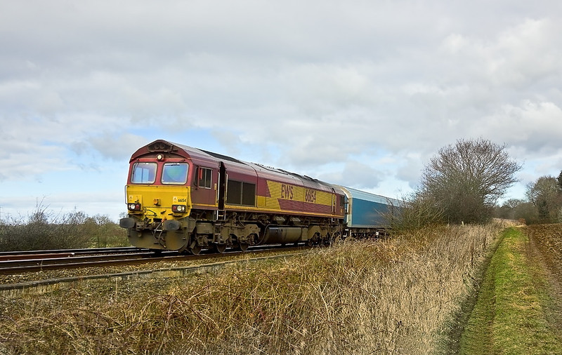 15th Feb 12:  66154 southbound between Mortimer and Bramley with the Cowley to Southampton Car Carriers