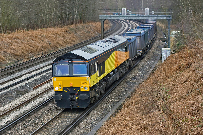 21st Feb 12:  66743 brings the Mountfield to Southampton empty Gypsum containers through Pirbright.  The loco will next go the Eastleigh Works for a repaint into Europorte Livery