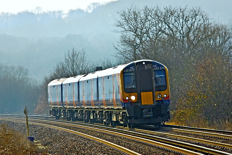 7th Feb 12: 450570 nearing Rusham Crossing in Prune Hill, Egham working the 12.03 from Weybridge to Waterloo