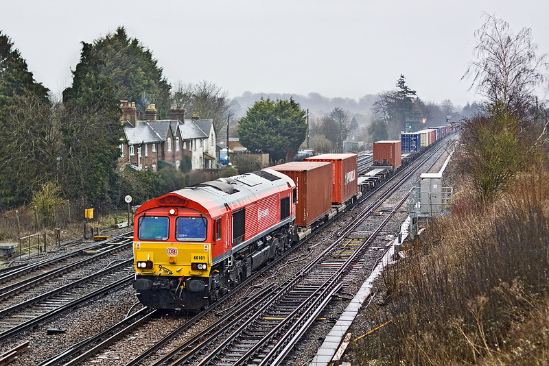 22nd Feb 12:  Carrot coloured 66101 heads through Worting in very unpleasant weather.  The working is 4O23 from Hams Hall to Southampton
