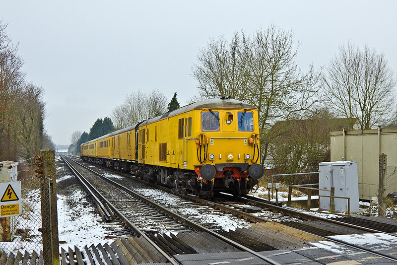 6th Feb 12:  On the return from Reading 73138 leads as the Radio Survey Train crosses the Waterloo Road level crossing on the Eastern outskirts of Wokingham