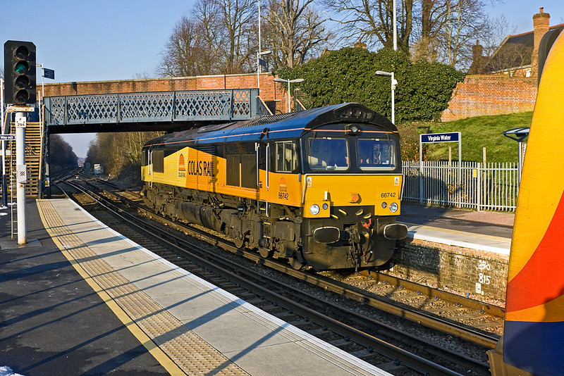 7th Feb 12:  0Y68 was for the move of  66742 from St Leonards to Eastleigh.. Seen here at Virginia Water with 450113 just moving away with the 15.03 from Weybridge to Waterloo