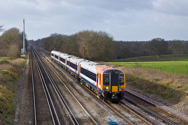 22nd Jan 12:  444017 forms 1B40 the 10.55 from Poole to Waterloo and is running on time as it passes Totters Lane