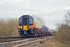 23rd Jan 12:  The 09.33 from Weybridge to Waterloo  (2S34) formed of 450550 has just crossed the M3 as it nears Virginia Water