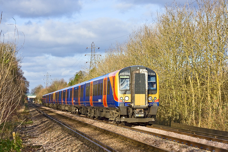 7th Jan 12:  Running down the grade into Guildford is 450034 forming 2P37 the 13.15 Waterloo to Hazlemere