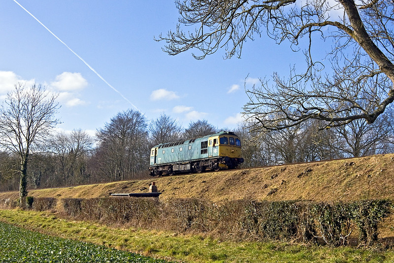 15th Jan 12:  Acting as a Thunderbird Crompton 33035 trundles up the hill to give 45379 a push up tp Medstead & Four Marks as it has stalled, due to slippery rails, in Soldridge cutting