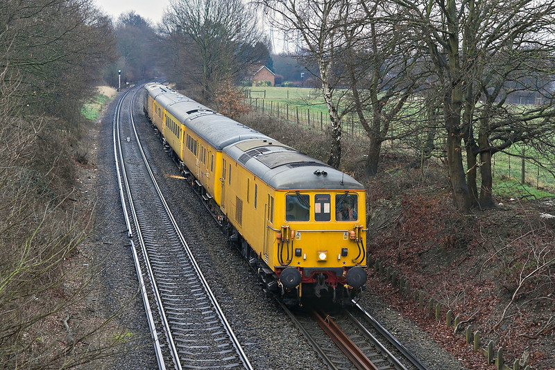 24th Jan 12:  1Q42, with 73138 now in the lead,  has just crossed over the M25 as it runs through Lyne on the return leg from Surbiton to Grove Park