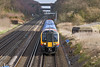 22nd Jan 12L  South West Trains 450118 working from Waterloo to Basingstoke drops down the grade away from Winchfield