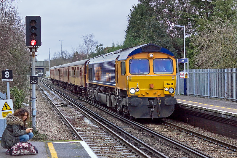 18th Jan 12:  London Underground's ex Southern Region 4TC trailer unit is seen here passing through Egham being hauled between West Ruislip and Eastleigh by GBRf 66711