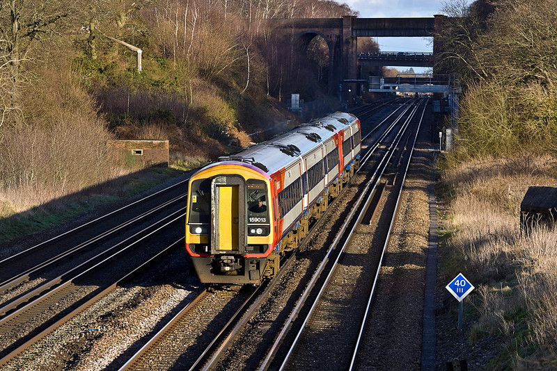 26th Jan 12:  the 14.20 from Waterloo to Exeter with 159013 doing the honours is captured at Totters Lane