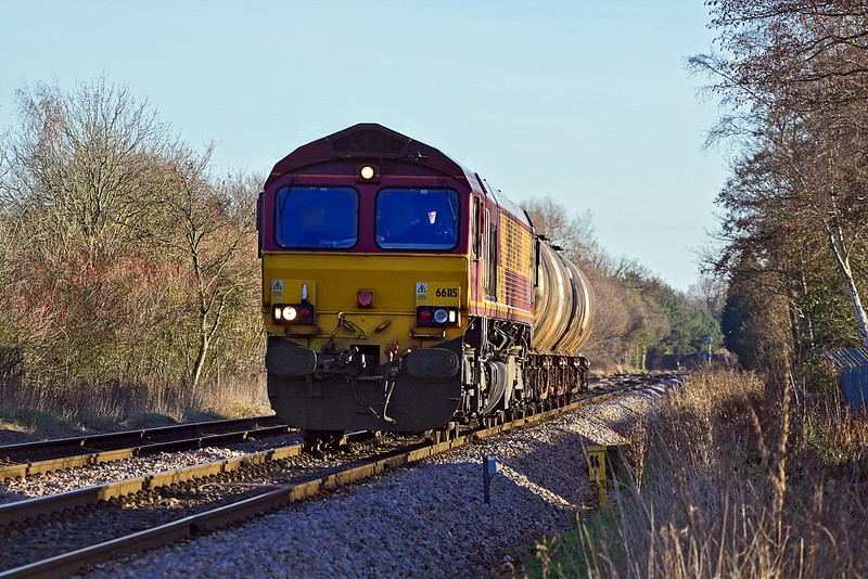 16th Jan 12:  66115 with the four TTAs containing Fuel Oil for Reading FGW Depot  (6V04) is captured from the Darby Green foot crossing between Blackwater and Sandhurst