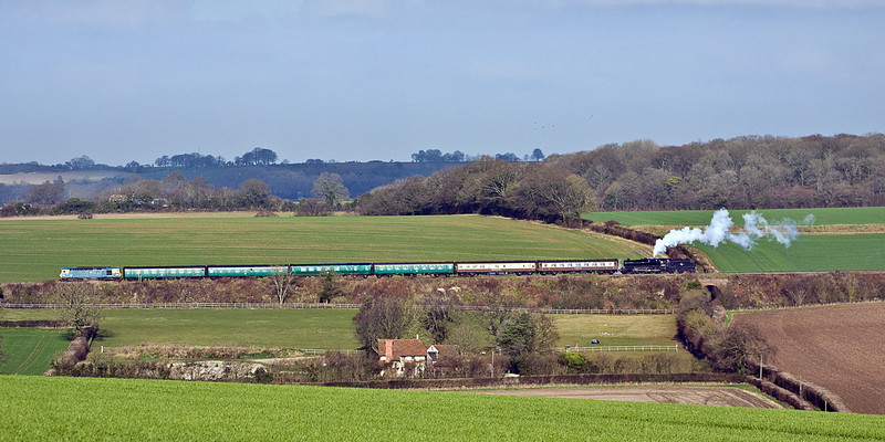 15th Jan 12:  Passing through Gundleton is Crompton 33035 leading  having been sent to rescue Black 5 45379 which had slipped to a halt in the frosty cutting near Soldridge.  The formation continued for the rest of the day