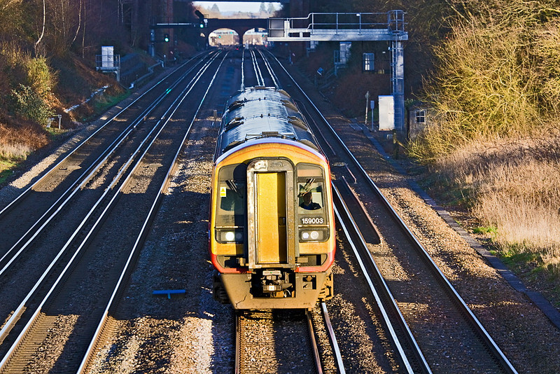 26th Jan 12:  159003 on the South Western Main Line with the station foot bridge at Winchfield visible under the two brick arches. Leaving Waterloo at 14.50 the destination is Salisbury
