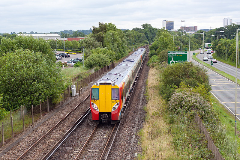18th Jul 12:  458023 is working 2C19 the 08.50 from Waterloo to Reading. Pictured at Amen Corner in Bracknell