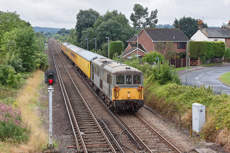 31st Jul 12:  On the Aldershot to Ascot leg of 1Q14's itinary 73107 leads as the TRC runs into Bagshot