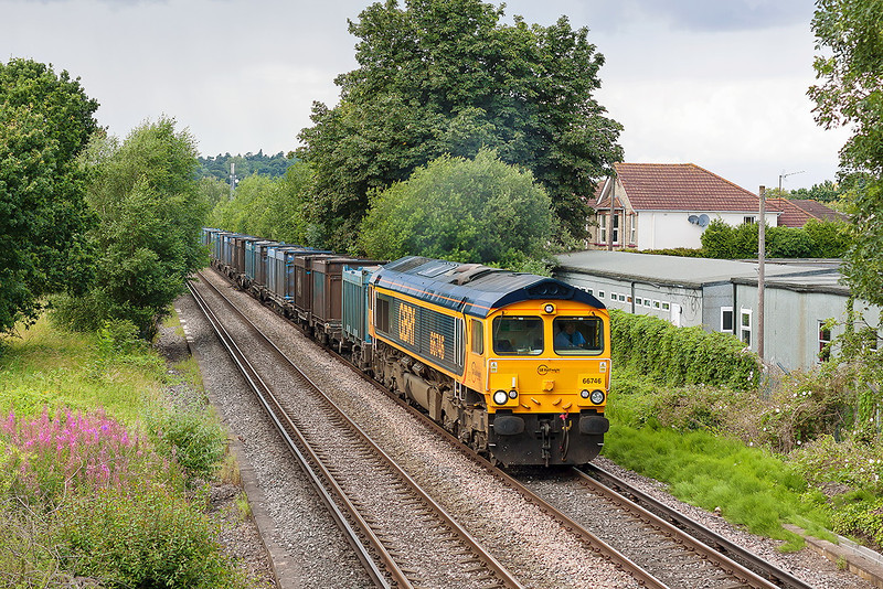 11th Jul 12:  Now in Europorte livery 66746 crosses Addlestone Moor in Chertsey  with 4Y19 the empty Gypsum containers from Mountfield to Southampton