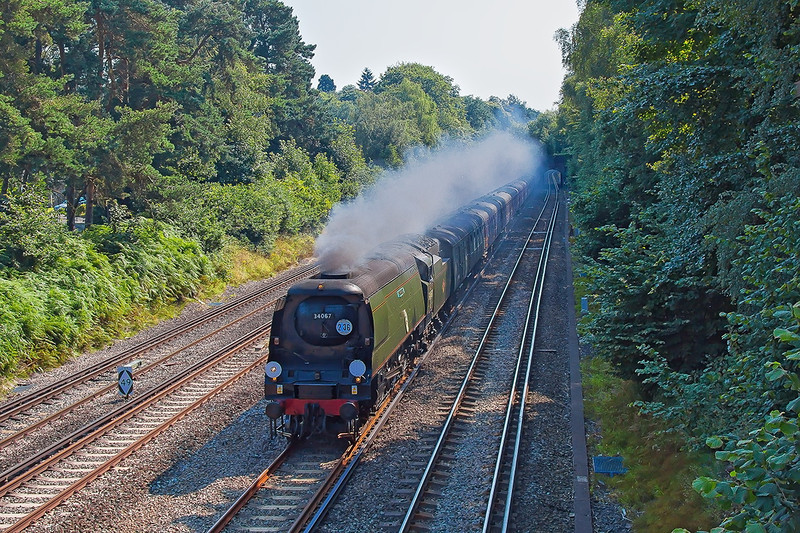26th Jul 12:  Passing through Frimley Green is Battle of Britain class 4-6-2 #34067 'Tangmere' in control of the Dorset Coast Express from Victoria to Weymouth.   It was diverted onto the slow line at Farnborough.