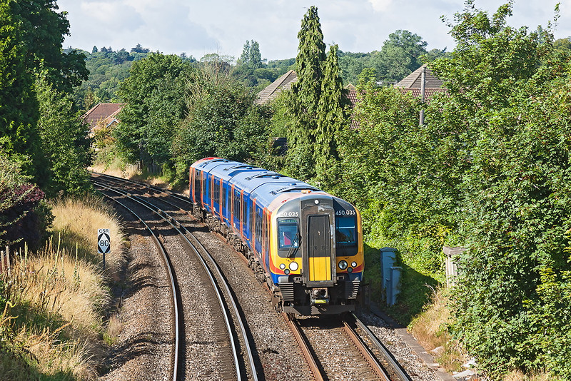 30th Jul 12:  The 09.03 from Weybridge to Waterloo, 2S22, approaches Egham worked by 450035