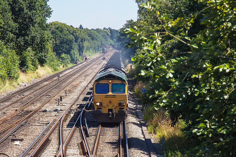 23rd Jul 12:  66512 heads west through Farnborough with the Nesden to Wool sand empties