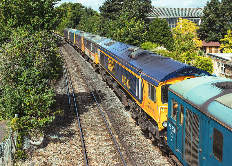 30th Jul 12: The monday morning GBRf  move from Eastleigh to St Leonard contained 66743 as one of the 7 locos.  Seen here at Pooley Green between Egham & Staines