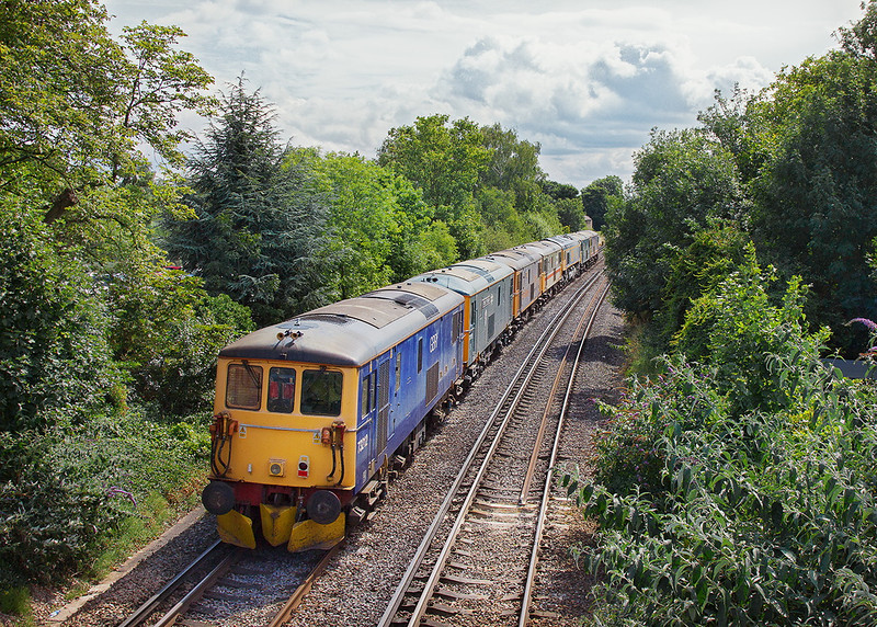 30th Jul 12: The Monday morning GBRf loco move from Eastleigh to St Leonard comprises, 73213/ 208/ 66743/ 73206/ 208/ 119/ 212.  Running as 0X66  the ensemble is pictured at Pooley Green near Staines