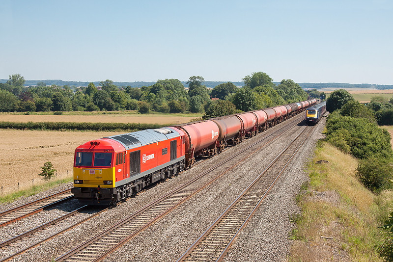 24th Jul 12:  60040 in sparkling condition is seen at Manor Farm in Cholsey with the empty Murco tanks returning to Robeston