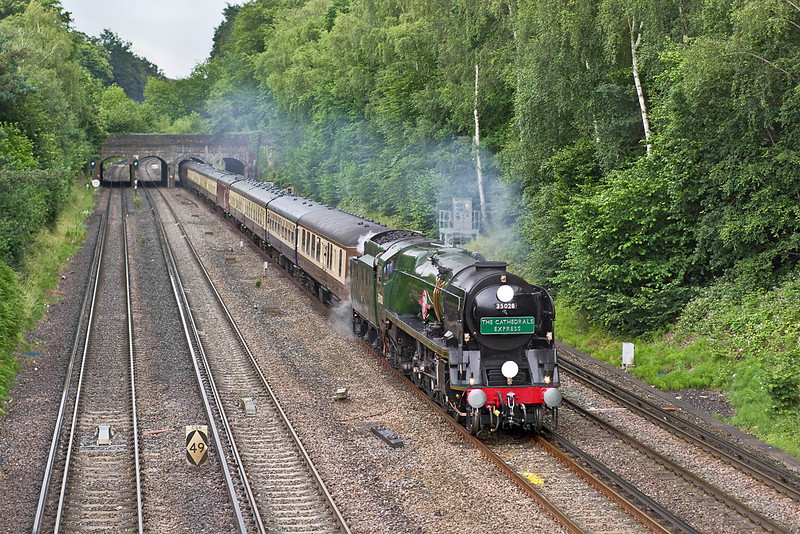 """9th Jul 12:  Sweeping under the Basingstoke Canal at Frimley Green is Merchant Navy Pacific 35028 """"Clan Line"""" heading for Weymouth.  This Cathedrals Express is to commemorate 45 years since the end of steam on this route."""