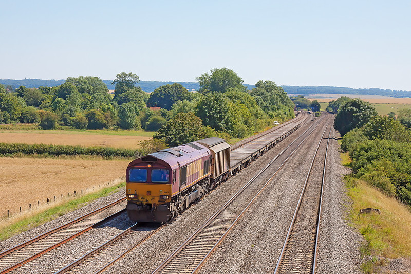 24th Jul 12:  66131 heads north on 6Z53 to Northallerton (Redmire) with empty Warflats from Ludgershall MoD
