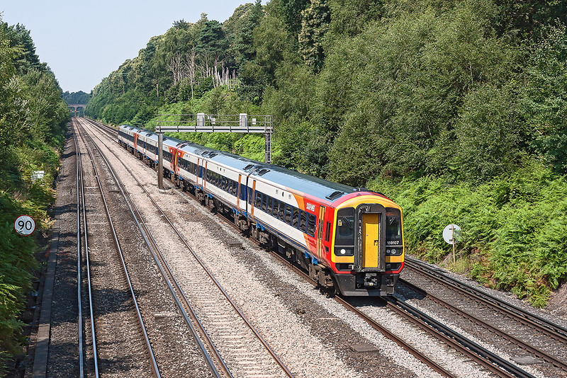 26th July 12:  159107 is on the point of 1L32 the 08.26 from Exeter to Waterloo.  With 159006 on the rear they are pictured at Pirbright