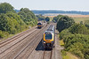 24th Jul 12:  The 13.40 Cross Country service from Reading to Newcastle has just overtaken 66131 on the empty Warflats to Northalleton at Cholsey.