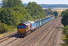24th Jul 12: 66090 heads V27 the afternoon departmental from Eastleigh to Hinksythrough Cholsey.  The load is a cable laying train