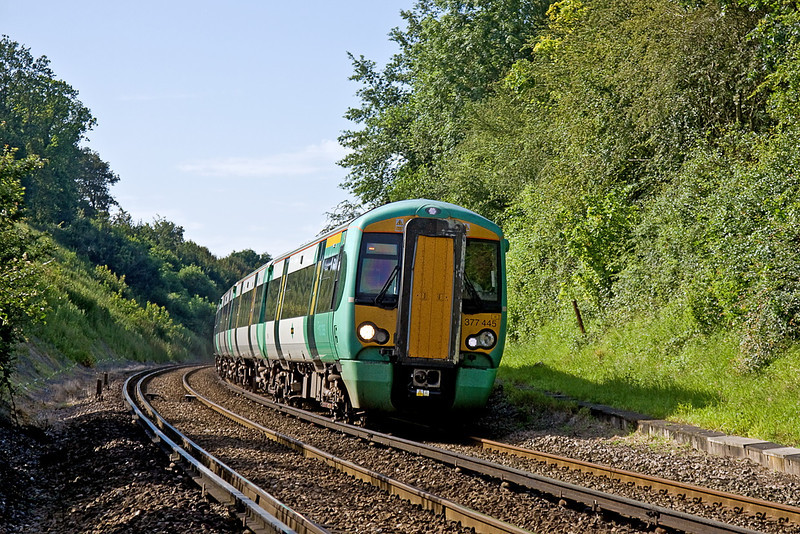 5th July 12:  377445 rounds the corner at Cooksbridge working 1F13 the 07.38 from Hastings to Victoria