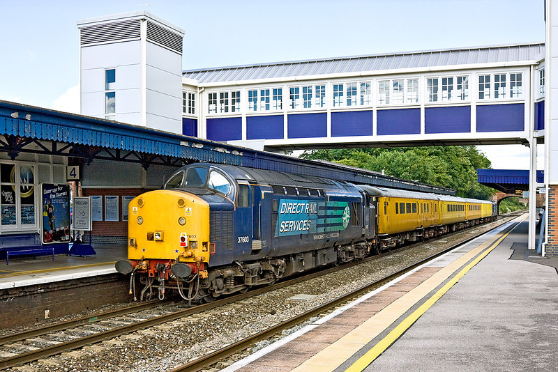 24th Jun 12:  1Z14 is the Network Rail test train working from Derby to Hither Green.  Top 'n Tailed by 37608 &37603 the ensemble is running 30 minutes early through Twyford