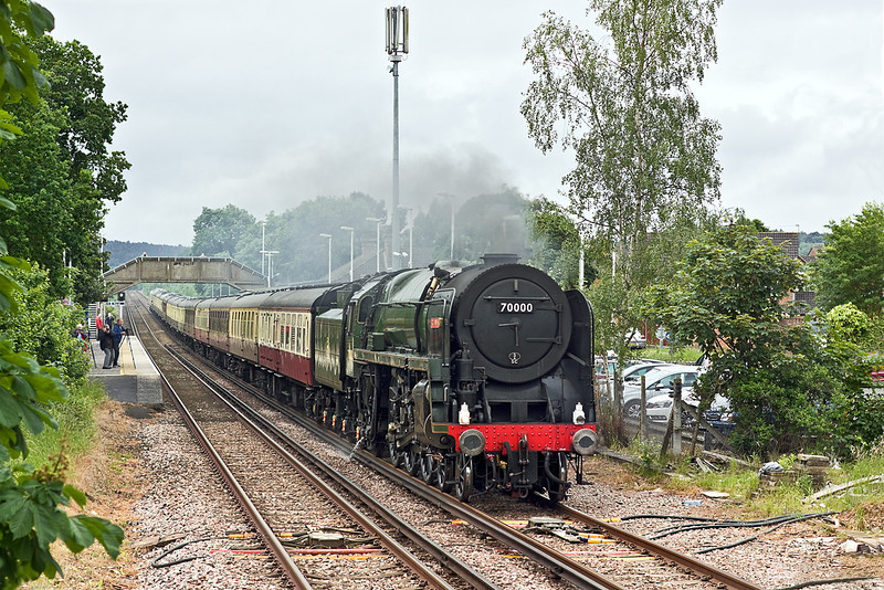 7th Jun 12:  The day's Cathedrals Express running from Arlesford to Ely is hauled by 70000 'Britannia'.  1Z88 is seen here powering through Bagshot