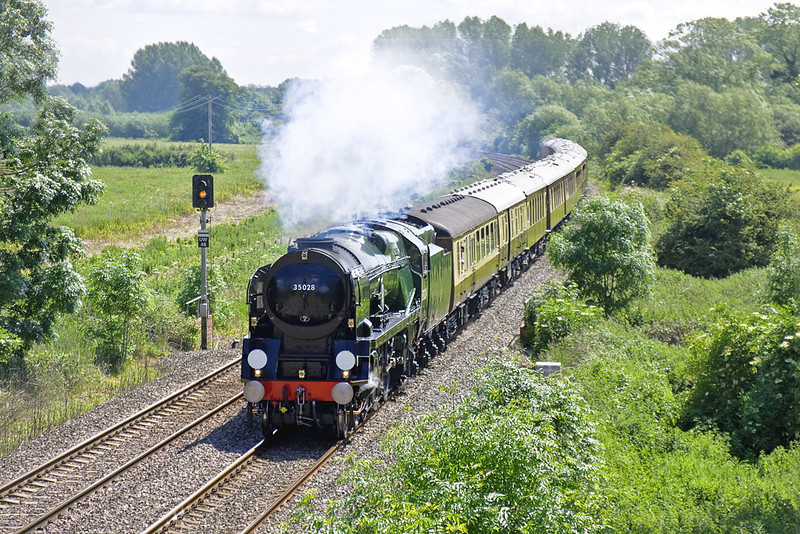 13th Jun 12:  35028 is powering the Orient Express from Victoria to Bristol Temple Meads.  1Z91 is captured from the Brimpton Road Bridge near Thatcham.  Unless there is some serious tree clearance this shot, like so many others, will shortly be lost.