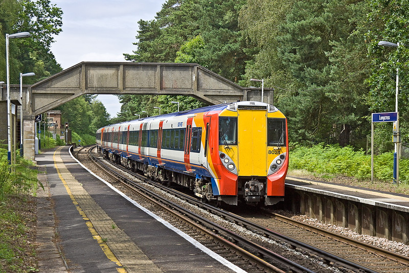 26th Jun 12:  Junipers 458024 and 8019 scream through Longcross while working 2C34 the 11.42 from Reading to Waterlooo