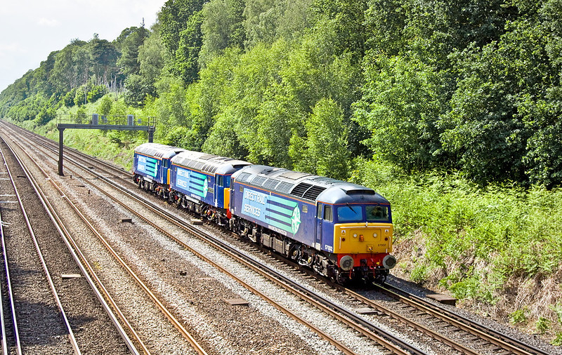 20th Jun 12: DRS 57002 hauls newly reliveried 57304 & 57302 through Pirbright on their way from Eastleigh to Willesden
