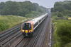21st Jun 12:   444031 makes for Weymouth on a very wet evening.  The location is Totters Lane between Winchfield and Hook