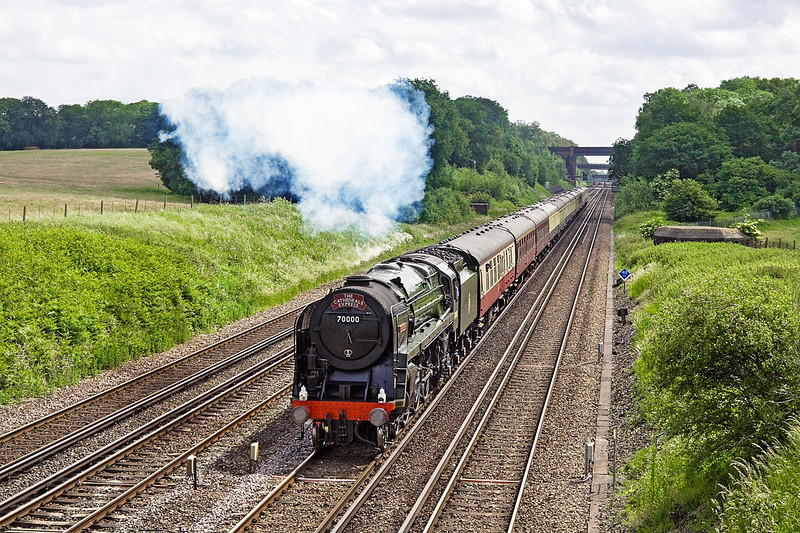 14th Jun 12:  Having just crossed over onto the Fast at Winchfield 70000 'Britannia' accelerates smartly away to the west.  The Cathedrals Express (1Z93) is running from Victoria to Swanage