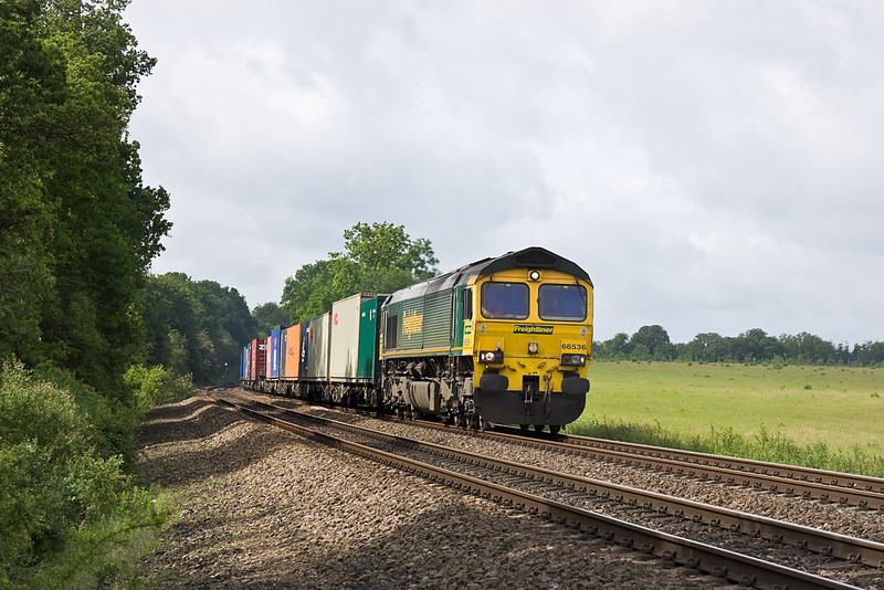 6th Jun 12:  Catching a patch of sunlight at Danes Crossing is 66536 working 4M66 from Southampton Maritime to Lawley Street