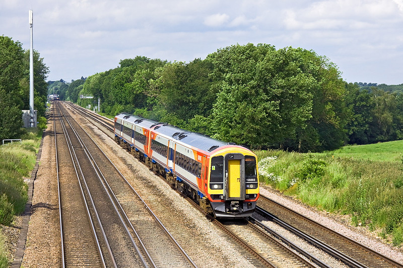 14th Jun 12:   Storming up the Fast line between Hook and Winchfield is 158883 & 159011. They are forming the 07.26 (1L28) frpm Exeter to Waterloo.